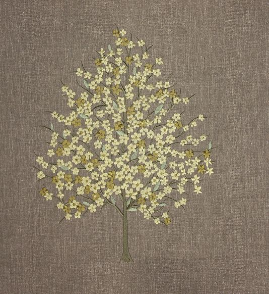 Chantilly Embroidered Fabric Tree of life style embroidered fabric. Leaves and flowers in golds on a taupe linen background.