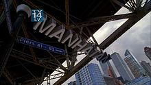 """Fringe (TV series) - Wikipedia, the free encyclopedia --  One of Fringe's location titles, using block letters that float in the foreground. In this example, from """"Olivia"""", the episode takes place in the parallel universe's version of Manhattan, which is spelled with only one """"t"""". Notice the World Trade Center in the background."""