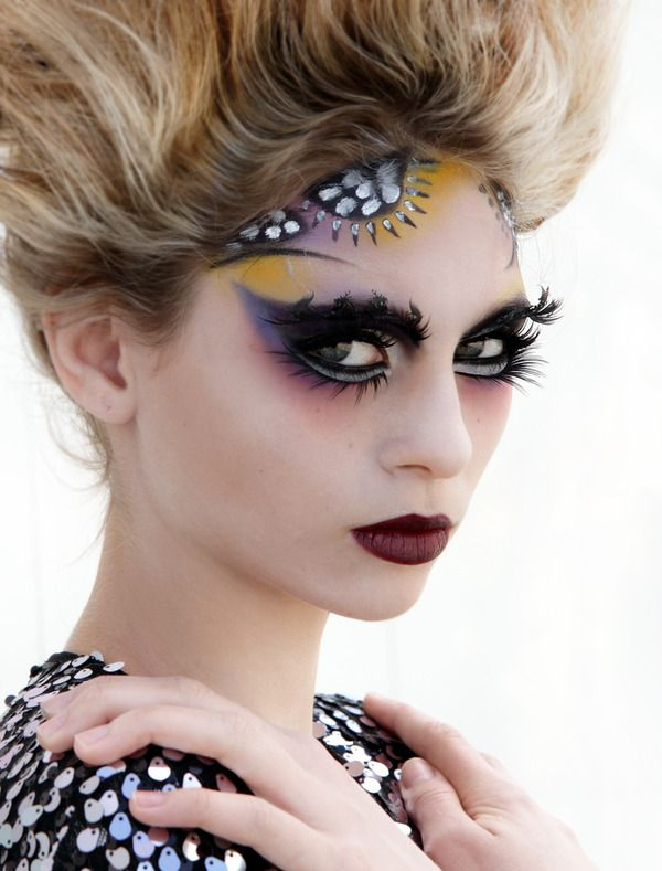 Avant-garde makeup- feather brows, dramatic eyes & lips. http://www.beautylish.com/f/gmnvri/color-me-beautiful