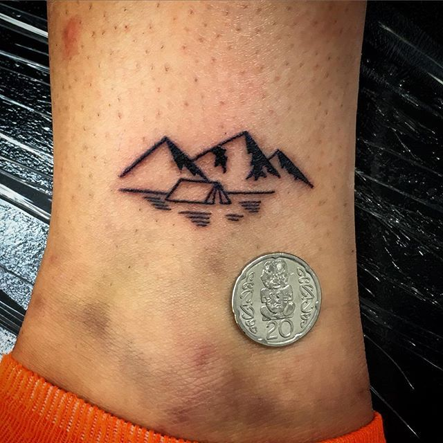 Instagram media stevierae_tattoo - Also got to make this tiny mountain range with a small tent! #tiny tattoos #smalltattoos #blacktattoos #mithraneedles #mickysharpzmachines #whitetigertattoo #whitetigertattooqueenstown #mountaintattoo #tenttattoo #lineworktattoo #queenstown #apprenticetattooist #tattooartist #queenstownholidays #scenerytattoo