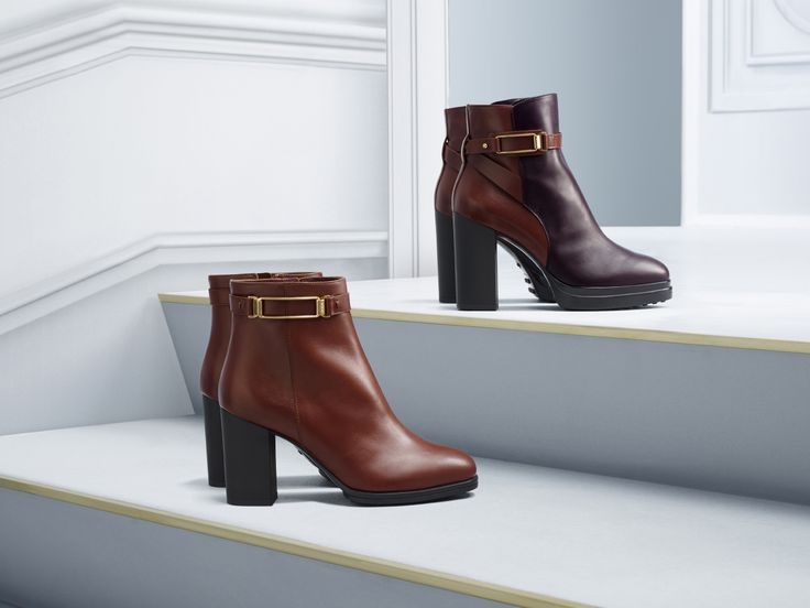 Ankle boots with smooth uppers and a two-tone version with  contrasting upper and plateau, distinguished by a military inspired buckle. #tods #womenswear #fw15