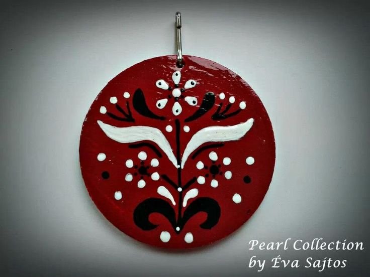 Red black and white handmade painted medal