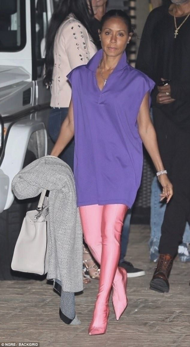 Colorful: Jada Pinkett Smith, 46, stood out from the crowd in a sleeveless purple tunic andbubblegum pink legging-boots as she left trendy Nobu restaurant in Malibu Sunday night
