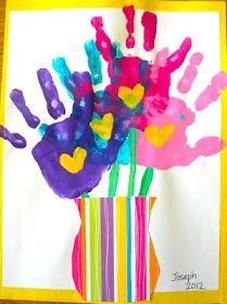 Finger paint handprints made into flowers great gift idea Also a great way to keep a memory of how small your kids were at a certain age ...just write their name and age to the flower pot