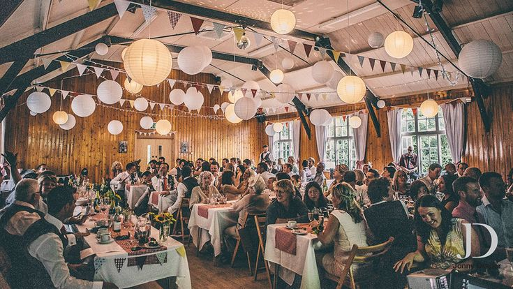 Use medium and large white wedding lanterns to set the scene for a Relaxed Boho wedding at your local village hall.