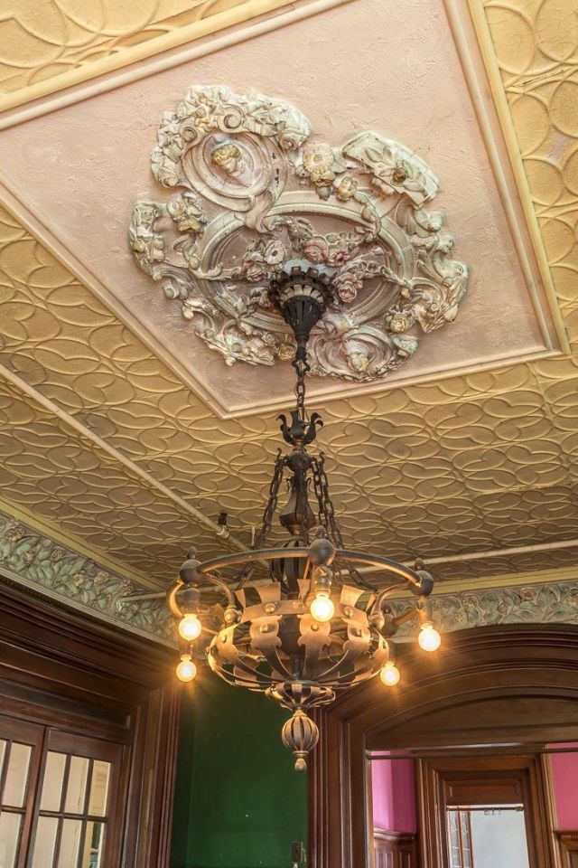 Spectacular historic light fixture and ceiling adornment in an 1879 Victorian, Davenport, IA.