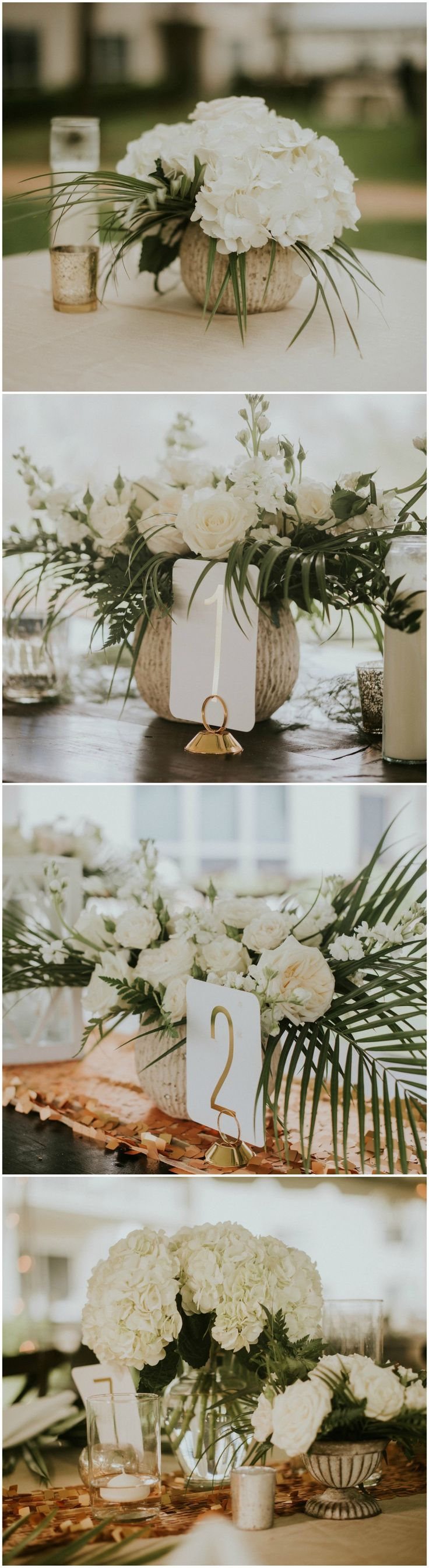 Wedding reception floral centerpieces, neutral, cream florals, tropical palm fronds, white roses, chic wedding decor, white and gold table numbers // Jessi Field Photography