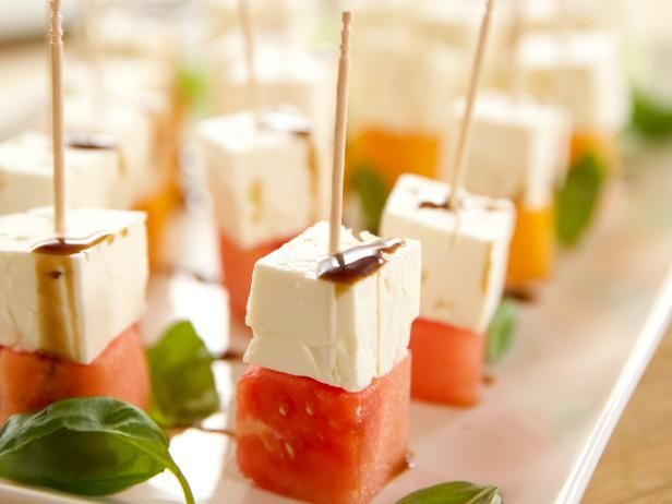 Get Melon Feta Bites Recipe from Food Network.... watermelon, honeydew, cantaloupe, basil