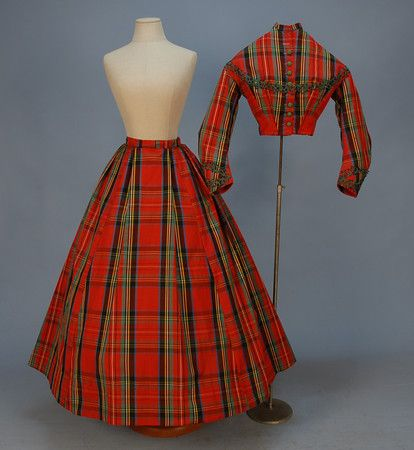 RED TARTAN PLAID SILK VISITING DRESS, 1860's. 2-piece with side boned bodice having green crochet buttons and soutache trim with black beads lined in brown cotton, skirt partially lined in glazed cotton.