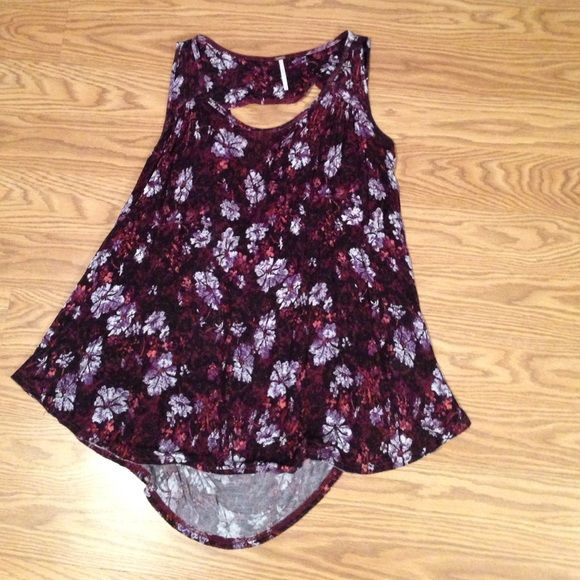 Free People floral purple top never worn. This top looks great on but I never got a chance to wear it because it was always too big to wear. Looks great with black for going out at night or with dark jeans. Tags still on! Fits like most Free People tops and is very flowy. Not tight at all. The top of the back is low which is also great if you want to put a black lace bandeau with it! Free People Tops Blouses