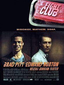"""""""FIGHT CLUB"""" is embossed on a pink bar of soap in the upper right. Below are head-and-shoulders portraits of Brad Pitt facing the viewer with a broad smile and wearing a red leather jacket over a decorative blue t-shirt, and Edward Norton in a white button-up shirt with a tie and the top button loosened. Norton's body faces right and his head faces the viewer with little expression. Below the portraits are the two actors' names, followed by """"HELENA BONHAM CARTER"""" in smaller print. Above the…"""