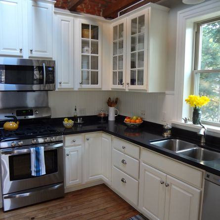 Salvaged cabinets, saved counters and smart design enabled this family to live large in a small kitchen footprint while sticking to a modest budget. | thisoldhouse.com/yourTOH