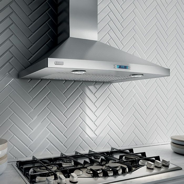 PILATO - The rounded front, beautifully sloping angles and stainless steel finish of this hood make it a striking visual statement.