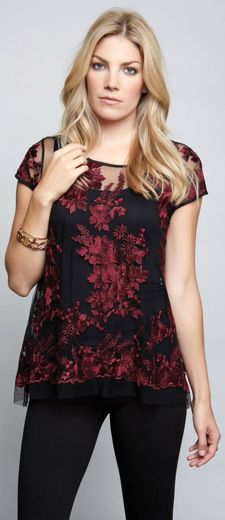 Elegant floral embroidery adds stunning detail to a sheer tulle top with a subtly flared silhouette.