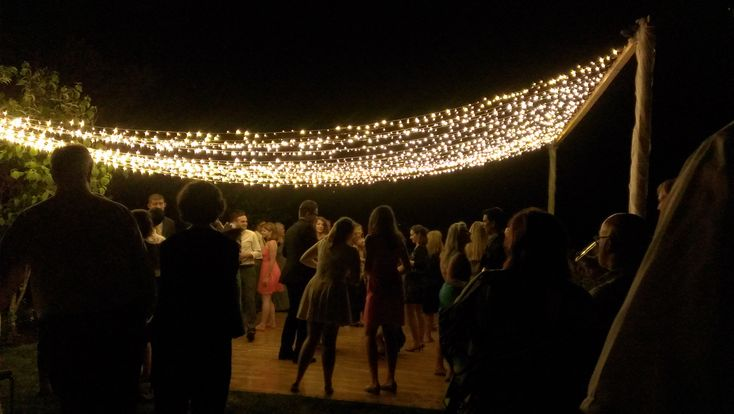 A Canopy Of Fairy Lights Over An Outside Dance Floor