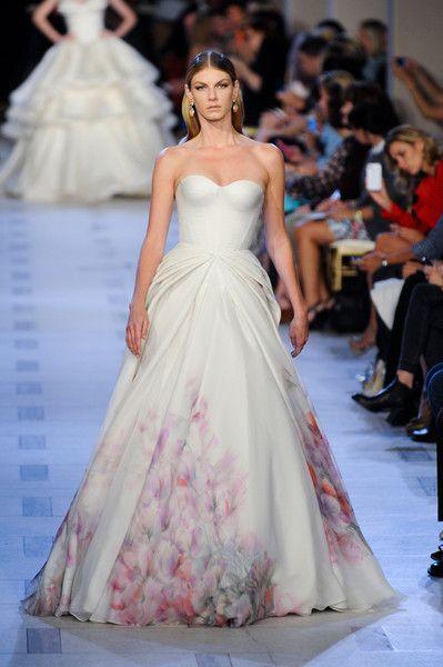 Zac Posen Spring 2013    Angela Lindvall's cherry-blossom-print triple-layer chiffon, organza, and tafetta bustier gown