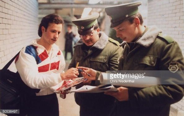 Figure skater, Brian Boitano (c), signing autographs for Hungarian soldiers while training for World Figure Skating Championships, Budapest, Hungary. (Photo by Chris Niedenthal/The LIFE Images Collection/Getty Images)