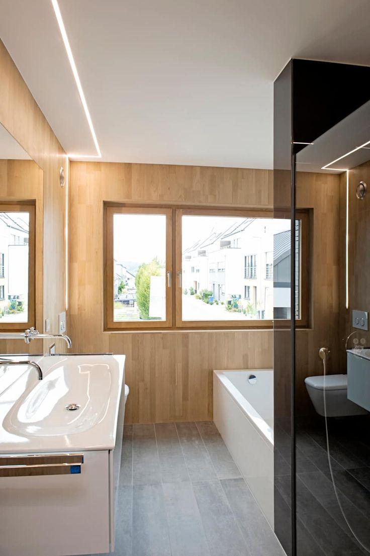 Hybrides und ökologisches einfamilienhaus aus beton und massivholz in mersch luxemburg moderne badezimmer