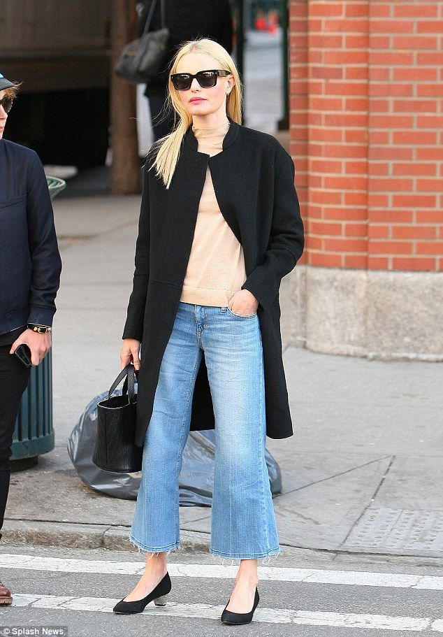 City style: Kate Bosworth was practically perfect in trench coat and flare jeans as she set off to run errands in New York's SoHo section on Wednesday