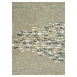 Tufted wool and art silk rug with a whimsical fish motif.   Product: RugConstruction Material: Wool and art silkColor: Blue and multiFeatures:  Plush pileHand-tuftedDurable Note: Please be aware that actual colors may vary from those shown on your screen. Accent rugs may also not show the entire pattern that the corresponding area rugs have.Cleaning and Care: Vacuum regularly. Blot spills immediately with cold water and mild soap. Periodic professional cleaning is recommended.
