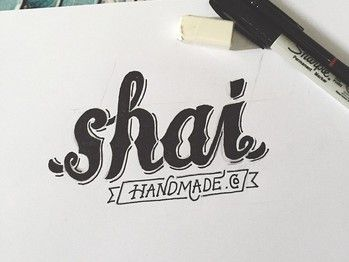 a hand lettered logotype for Shai Handmade