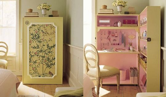It's a desk hidden in an armoire made from two bookshelves.
