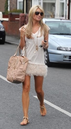 Model Alex Curran Gerrard wears Haute Hippie's ruffled t-shirt dress while out and about.
