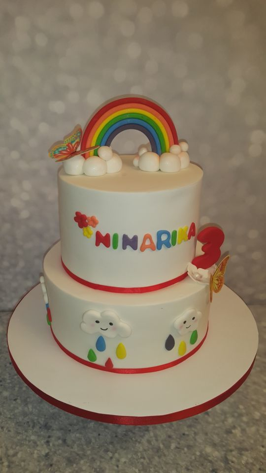 Rainbow and kawai clouds birthday cake