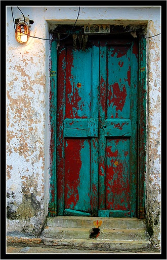 Old turquoise door that was scarlet in another life...