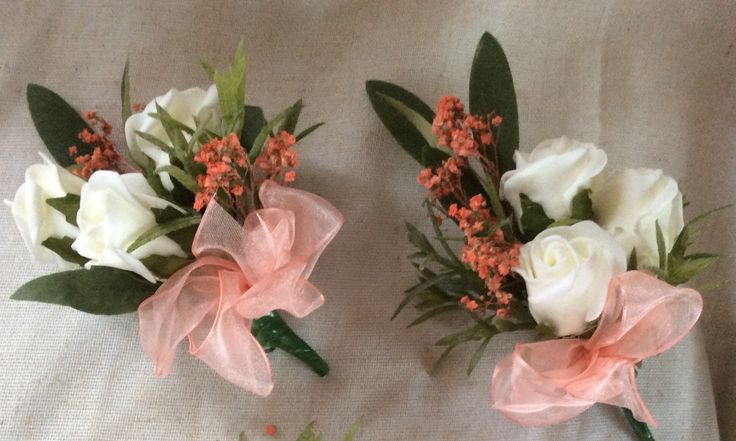 Peach and ivory corsages on magnets by Cathey's flowers
