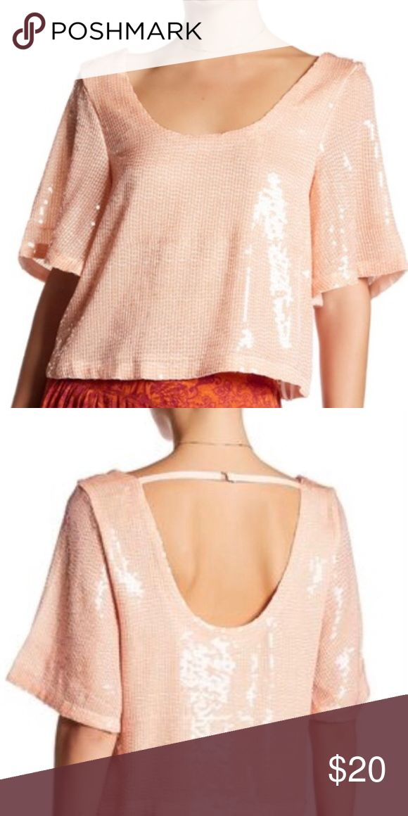 """New Free People """"Friday Night Fever"""" sequin top NWT Free People """"Friday Night Fever"""" sequin top in """"Pearl"""" (is more of a peach color)  Designed to elegantly drape around your frame, this slightly slouchy tee is cut with a generously scooped neck and back and illuminated by scores of shimmering sequins.  21"""" length (size Medium)  Scooped neck  Elbow sleeves  Lined Free People Tops"""