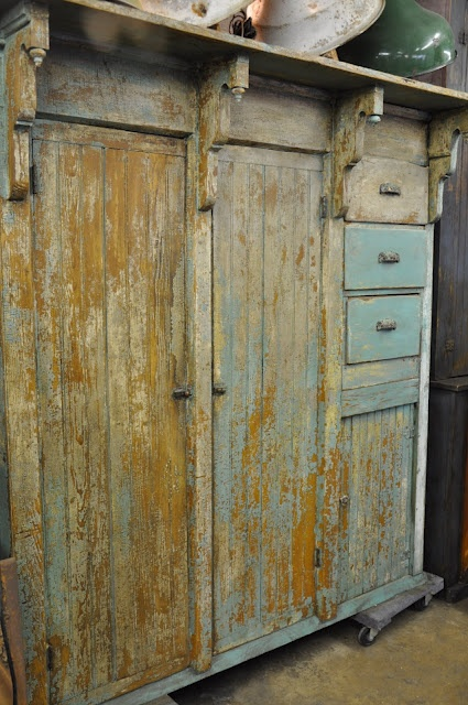 beautiful cabinet,built in top shelf, chipped cream and pale blue