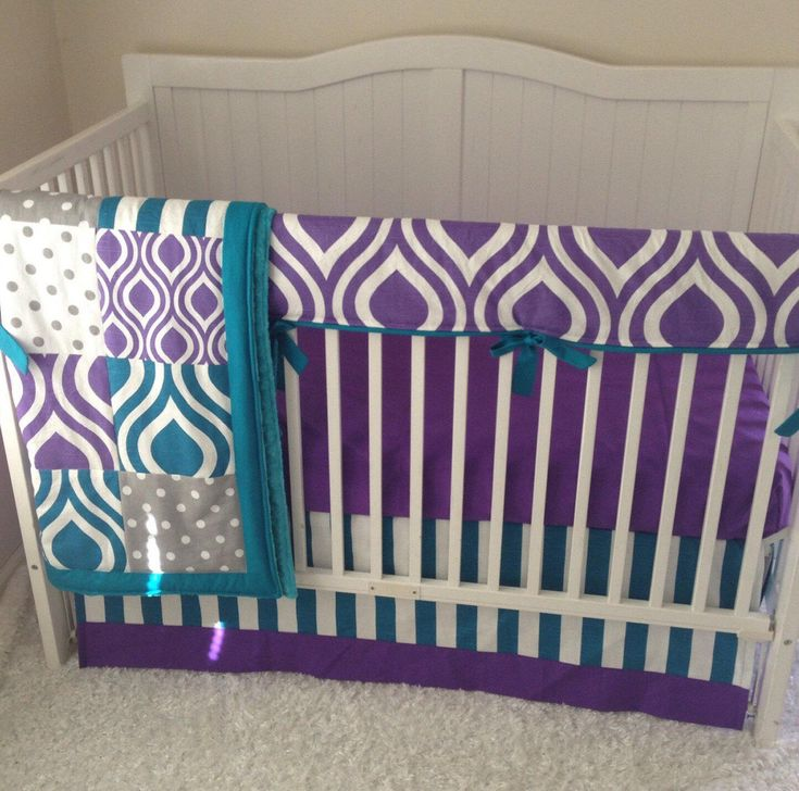 A personal favorite from my Etsy shop https://www.etsy.com/listing/105514067/modern-purple-gray-and-teal-baby-girl  Peacock themed baby girl crib bedding in purple and teal