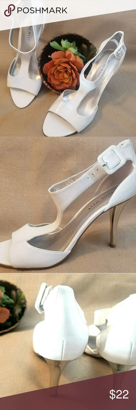 Nine West women's heels open toe WHITE 6 1/2 M Women's White Dress heels from Nine West in size 6.5 M open toe with buckle ankle strap. Heels are metallic silver. Soles have some wear as shown otherwise very nice condition. Perfect to wear under a wedding gown. Nine West Shoes Heels