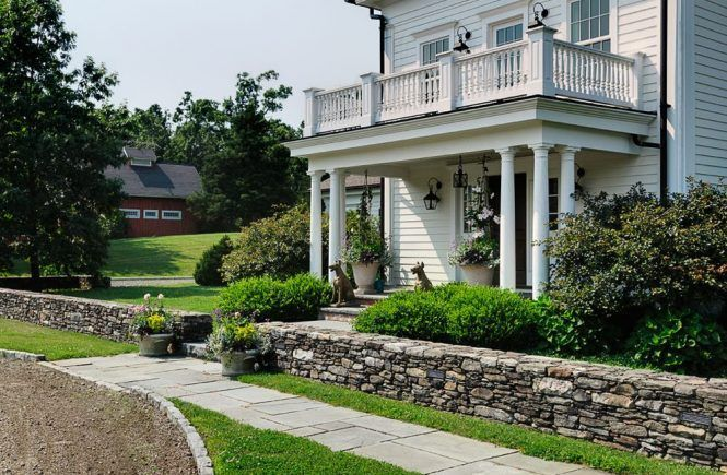 front porch railing exterior farmhouse with large window traditional outdoor pizza ovens