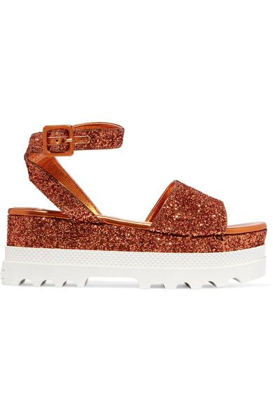 Platform sole measures approximately 60mm/ 2.5 inches Orange glittered leather Buckle-fastening ankle strap Designer color: Rame Made in Italy