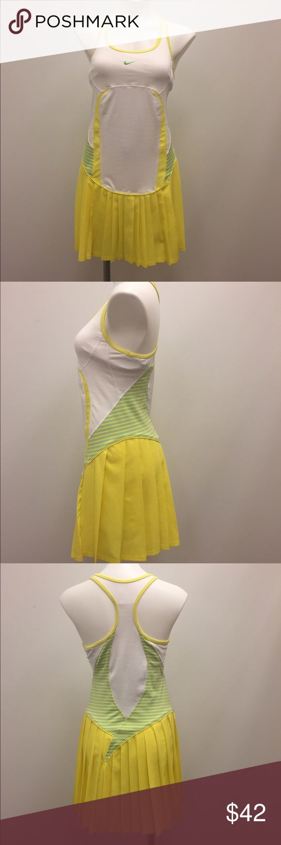 Nike fitdry multicolor athletic Pleated skrt dress Nike fitdry womens white textured dress with yellow pleated skirt, razor back and striped accent detail. It is a size medium and is in very good condition with light wear. It is made of polyester, nylon, and spandex. It features a built in non-padded shelf like bra area. It measures 33.5 inches from top of shoulder seam to bottom hem, and 15 inches from armpit to armpit. Nike Dresses