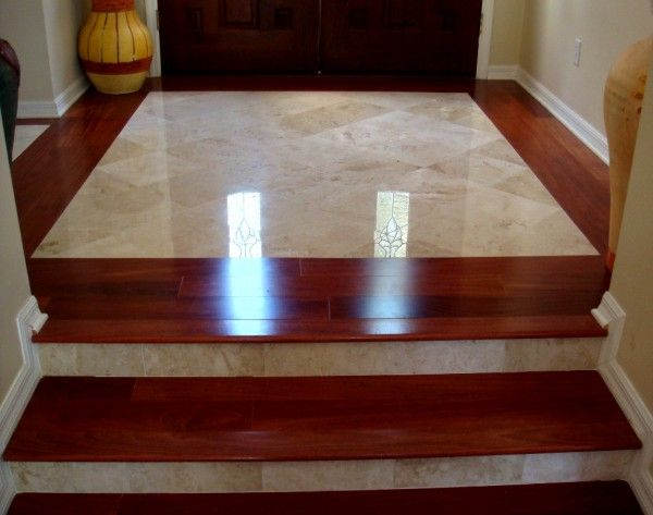 flooring wondrous small entryway tile ideas using cappuccino marble floor tiles toward double wooden entry doors in raised door panels closed to large yellow floor vases