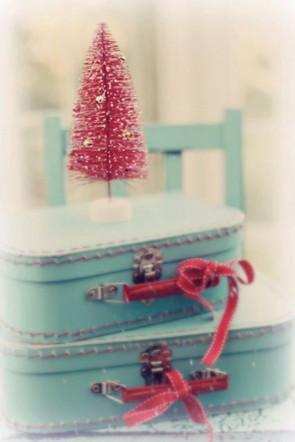 I have red suitcases. Will add turquoise ribbon and a turquoise tree for a corner vignette.