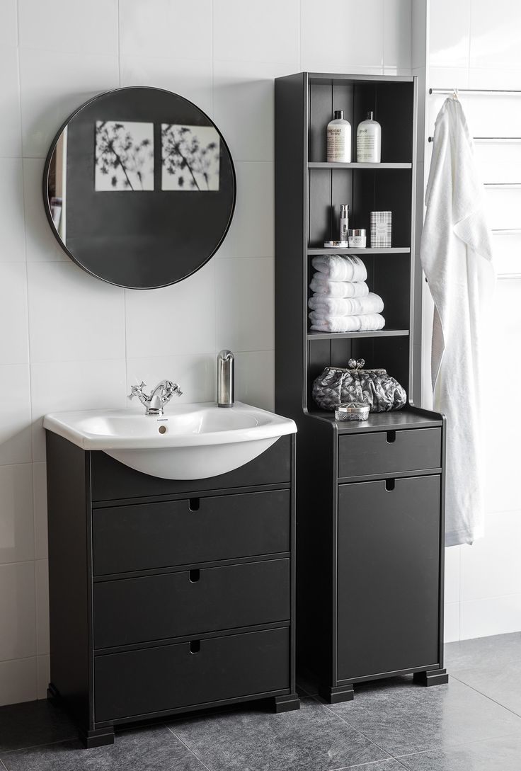 SVEA vanity unit 70 black. Classic porcelain washbasin. SVEA tall cabinet. SVEA round mirror.