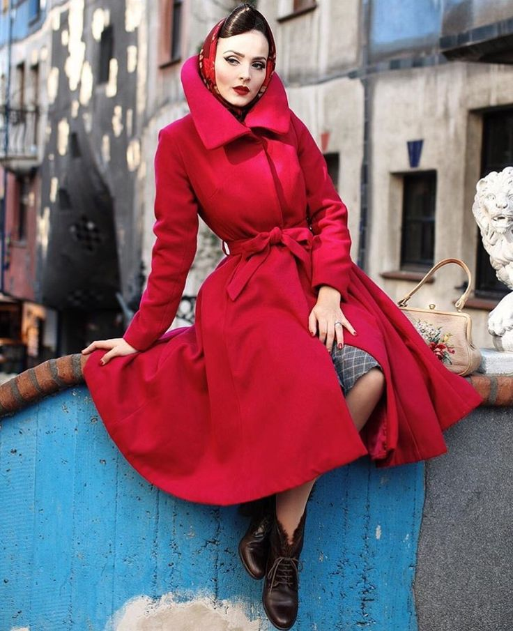 Ah such a resplendent RED......and the composure to wear it....LOVE this photo, with the vibrant blue against the fabric of the coat...and the red lip on the lady...and stance of calm.....LOVE this!