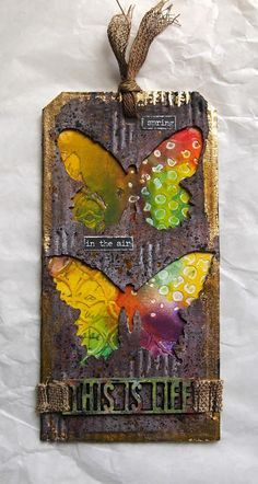 klistersøster: Tim Holtz 12 Tags of 2016 - March - Tim Holtz #8 tag, Distress ink ground espresso, black soot,. Distress paint tarnished brass, candied apple, twisted citron and black soot. Distress spray stain hickory smoke and pumice stone. Butterfly duo die and thinlit mixed media #1. Linen ribbon, small talk and Alpha parts framed. Corrugated cardboard, canvas band and Gelatos Colors.