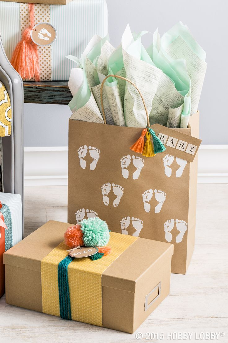 Stamp simple brown wrapping boxes and bags for a lovely DIY baby-shower gift wrap idea.