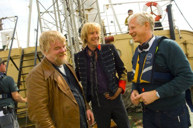 "Philip Seymour Hoffman, Rhys Ifans, Richard Curtis on the set of ""The Boat That Rocked"""