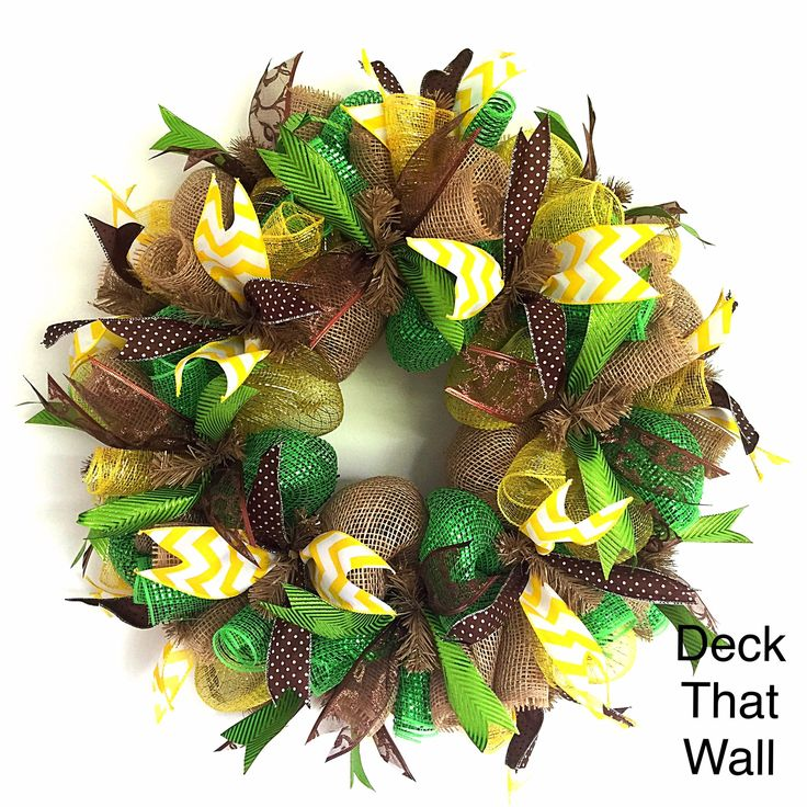 This beautiful mesh wreath is made with three different colors of mesh, featuring Natural Poly Burlap, Green Premium, and Yellow Deluxe. There are four different wired ribbons used on the wreath, feat