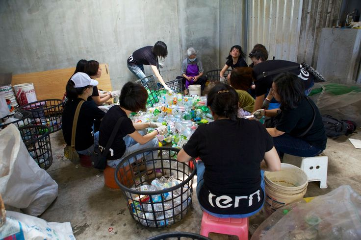 Sorting bottles as part of a volunteer activity at a local recycling center to help celebrate Tern's second birthday.