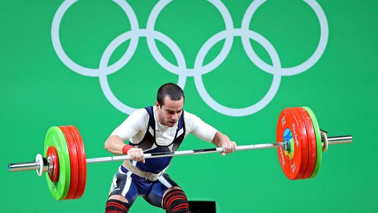 2016-08-08-rio-olympics-weightlifting:    Julio Cesar Acosta Gonzalez of Chile fails at a lift during the men's weightlifting 62kg preliminaries in the Rio 2016 Summer Olympic Games at Riocentro - Pavilion 2.