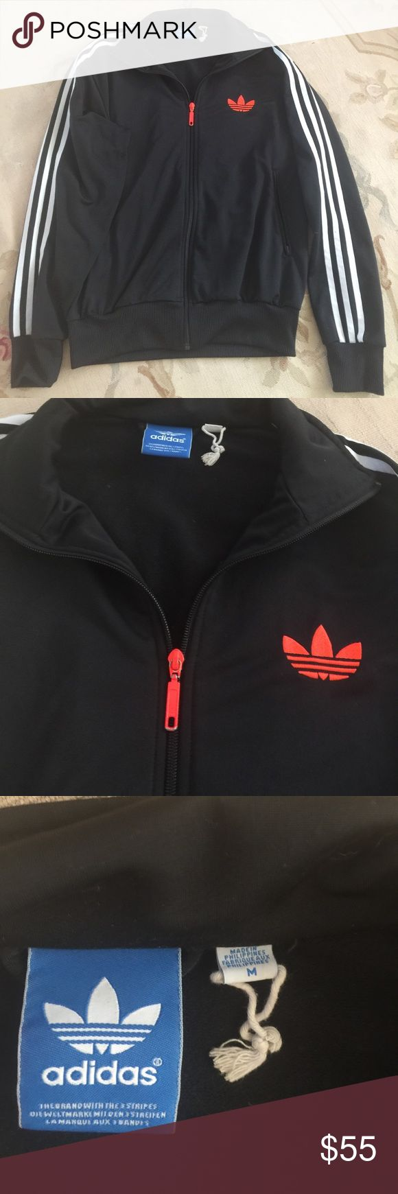Pre owned Adidas zip up Jacket size medium Signature Adidas black and white stripe zip up jacket size medium with neon zipper and Adidas symbol in great preowned condition Adidas Jackets & Coats