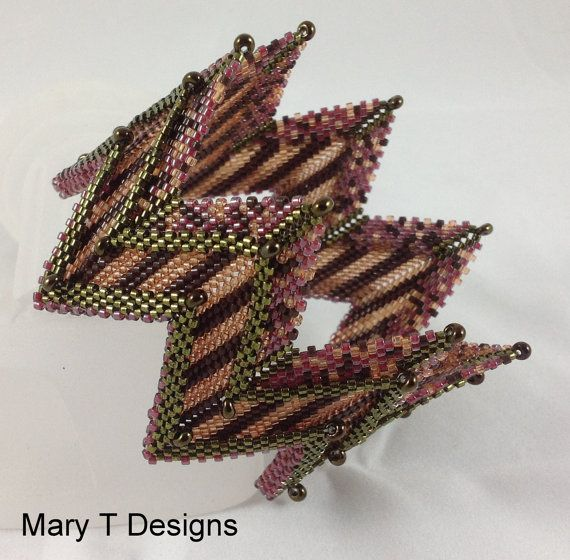 """Zig Zag Bangle Bracelet...This bracelet design was inspired by techniques found in """"Contemporary Geometric Beadwork"""" by Kate McKinnon. The """"belly-band"""" base of the bracelet was designed by Kate. It is a fun and easy method to begin a zig zag peyote cuff."""