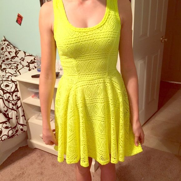 "An express neon yellow dress A bright ""a line/form fitting"" dress. It's about knee length. Express Dresses"